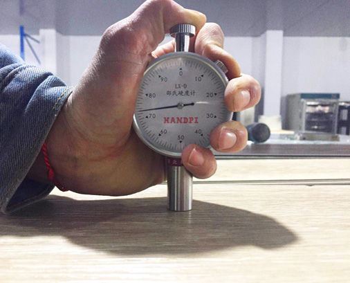 Hardness test on surface of wpc flooring