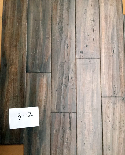 Distressed hand scraped strand woven bamboo flooring